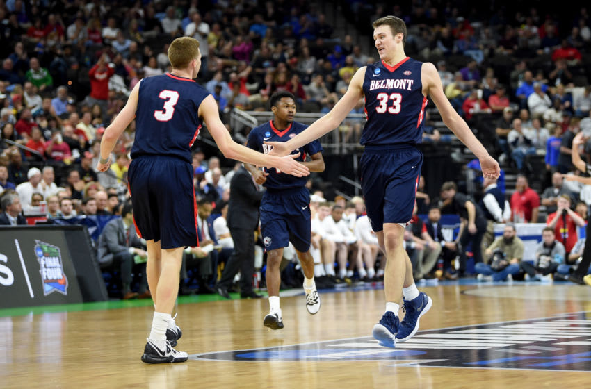 JACKSONVILLE, FL - MARCH 21: Nick Muszynski #33 of the Belmont Bruins celebrates with Dylan Windler #3 against the Maryland Terrapins in the First Round of the NCAA Basketball Tournament at Jacksonville Veterans Memorial Arena on March 21, 2019 in Jacksonville, Florida. (Photo by G Fiume/Maryland Terrapins/Getty Images)