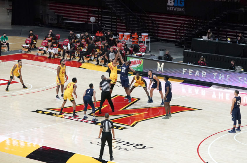 COLLEGE PARK, MD - NOVEMBER 27: Tip off between the the Maryland Terrapins and the Navy Midshipmen during a college basketball game on November 27, 2020 at the Xfinity Center in College Park, Maryland. (Photo by Mitchell Layton/Getty Images)