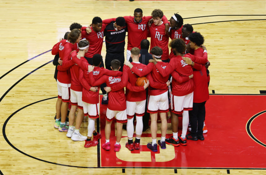PISCATAWAY, NJ - DECEMBER 08: The Rutgers Scarlet Knights huddle before their NCAA basketball game against the Syracuse Orange at Rutgers Athletic Center on December 8, 2020 in Piscataway, New Jersey. (Photo by Rich Schultz/Getty Images)