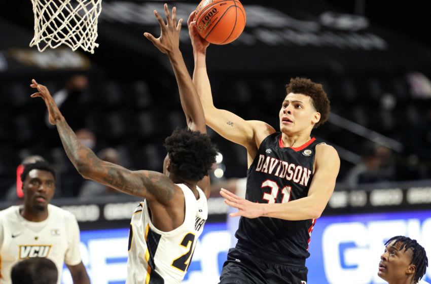 RICHMOND, VA - MARCH 06: Kellan Grady #31 of the Davidson Wildcats shoots the ball against Hason Ward #20 of the VCU Rams in the second half during the semifinal game of the Atlantic 10 Men's Basketball Tournament at Siegel Center on March 6, 2021 in Richmond, Virginia. (Photo by Ryan M. Kelly/Getty Images)
