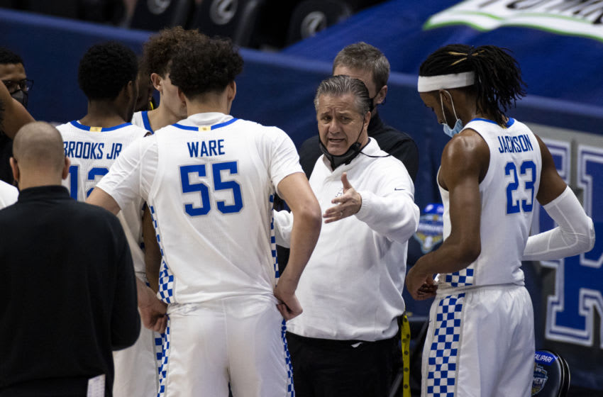 NASHVILLE, TN - MARCH 11: Head coach John Calipari of the Kentucky Wildcats instructs his players in a time out against the Mississippi State Bulldogs during the first half of their second round game in the SEC Men's Basketball Tournament at Bridgestone Arena on March 11, 2021 in Nashville, Tennessee. (Photo by Brett Carlsen/Getty Images)