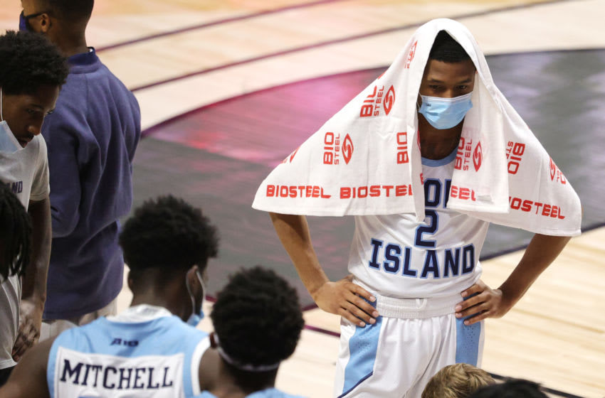 UNCASVILLE, CONNECTICUT - NOVEMBER 25: Jeremy Sheppard #2 of the Rhode Island Rams looks on wearing his mask in a huddle with teammates during the 2K Empire Classic game against the Arizona State Sun Devils at Mohegan Sun Arena on November 25, 2020 in Uncasville, Connecticut. (Photo by Maddie Meyer/Getty Images)