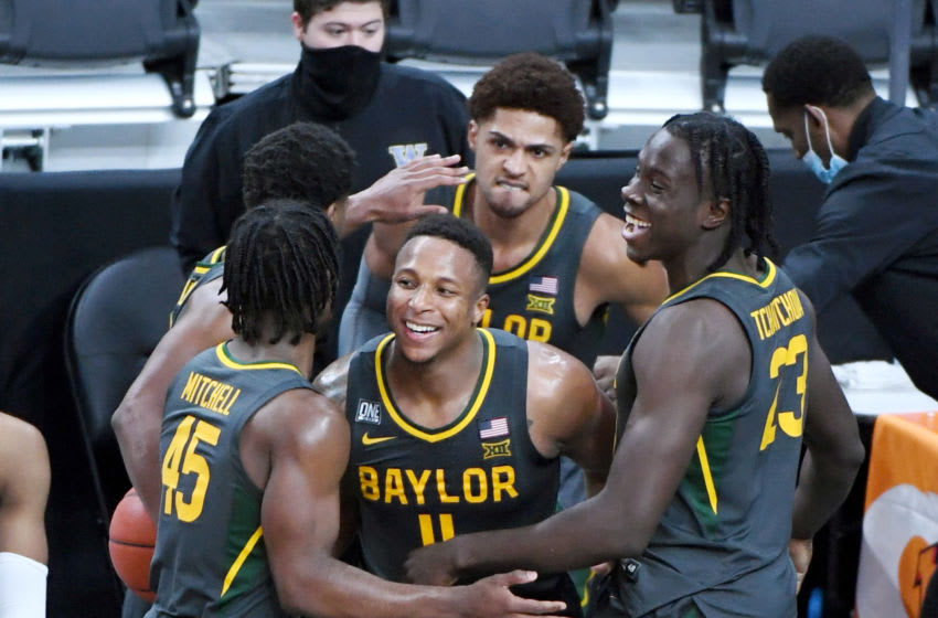LAS VEGAS, NEVADA - NOVEMBER 29: Davion Mitchell #45, Mark Vital #11 and Jonathan Tchamwa Tchatchoua #23 of the Baylor Bears celebrate after Vital saved the ball from going out of bounds against the Washington Huskies in the second half of their game during the #VegasBubble basketball tournament at T-Mobile Arena on November 29, 2020 in Las Vegas, Nevada. The Bears defeated the Huskies 86-52. (Photo by Ethan Miller/Getty Images)