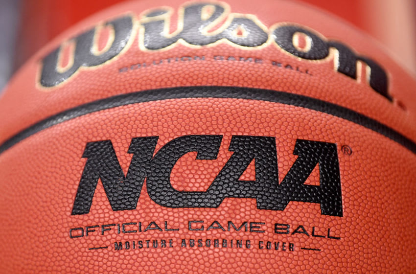 COLLEGE PARK, MD - DECEMBER 31: A view of the NCAA logo on a basketball before the game between the Maryland Terrapins and the Michigan Wolverines at the Xfinity Center on December 31, 2020 in College Park, Maryland. (Photo by G Fiume/Maryland Terrapins/Getty Images)