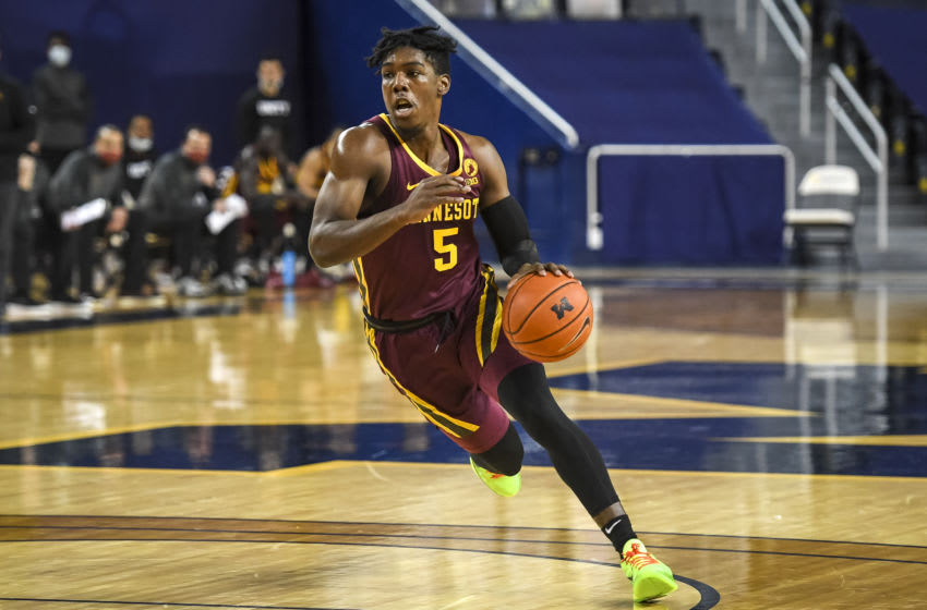 ANN ARBOR, MICHIGAN - JANUARY 06: Marcus Carr #5 of the Minnesota Golden Gophers drives to the basket against Michigan Wolverines during the first half at Crisler Arena on January 06, 2021 in Ann Arbor, Michigan. (Photo by Nic Antaya/Getty Images)