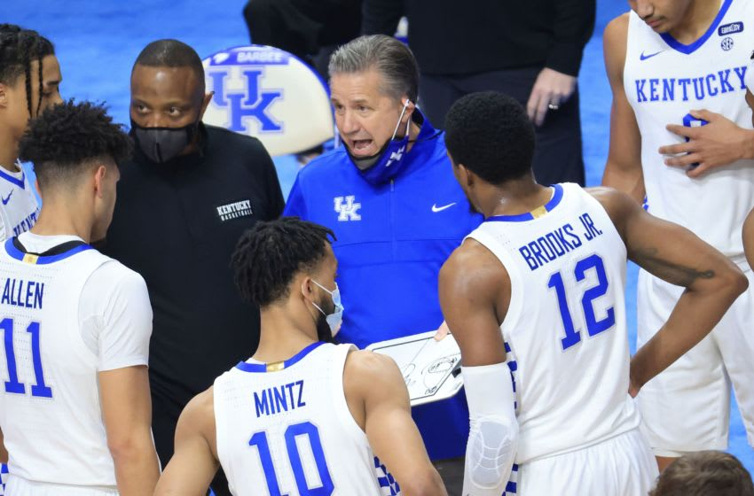LEXINGTON, KENTUCKY - FEBRUARY 09: John Calipari the head coach of the Kentucky Wildcats shoots gives instructions to his team against the Arkansas Razorbacks at Rupp Arena on February 09, 2021 in Lexington, Kentucky. (Photo by Andy Lyons/Getty Images)