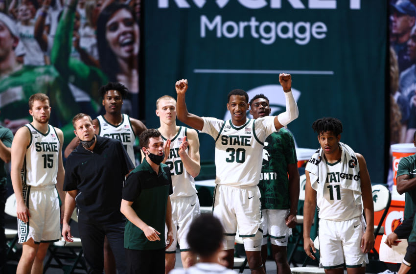 EAST LANSING, MICHIGAN - FEBRUARY 25: Marcus Bingham Jr. #30 and the Michigan State Spartans celebrate after their win over the Ohio State Buckeyes at Breslin Center on February 25, 2021 in East Lansing, Michigan. (Photo by Rey Del Rio/Getty Images)