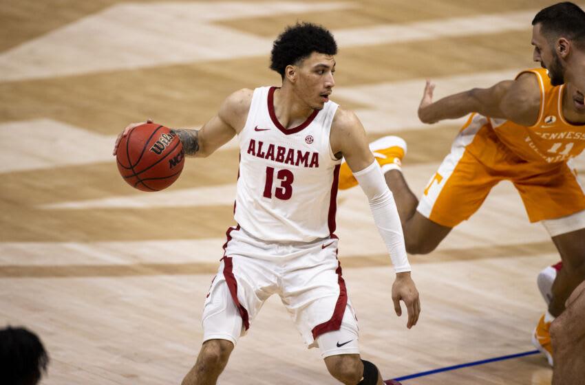 NASHVILLE, TN - MARCH 13: Jahvon Quinerly #13 of the Alabama Crimson Tide drives to the basket against the Tennessee Volunteers during the second half of their semifinal game in the SEC Men's Basketball Tournament at Bridgestone Arena on March 13, 2021 in Nashville, Tennessee. Alabama defeats Tennessee 73-68. (Photo by Brett Carlsen/Getty Images)