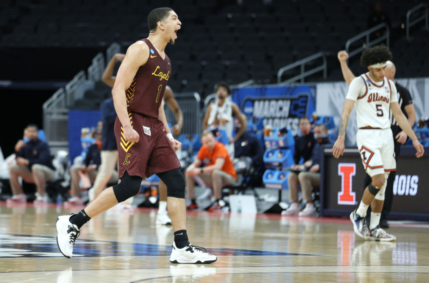 INDIANAPOLIS, INDIANA - MARCH 21: Lucas Williamson #1 of the Loyola Chicago Ramblers celebrates a play against the Illinois Fighting Illini during the second half in the second round game of the 2021 NCAA Men's Basketball Tournament at Bankers Life Fieldhouse on March 21, 2021 in Indianapolis, Indiana. (Photo by Sarah Stier/Getty Images)