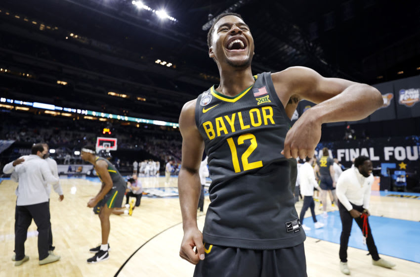 INDIANAPOLIS, INDIANA - APRIL 05: Jared Butler #12 of the Baylor Bears celebrates after winning the National Championship game of the 2021 NCAA Men's Basketball Tournament against the Gonzaga Bulldogs at Lucas Oil Stadium on April 05, 2021 in Indianapolis, Indiana. The Baylor Bears defeated the Gonzaga Bulldogs 86-70. (Photo by Jamie Squire/Getty Images)