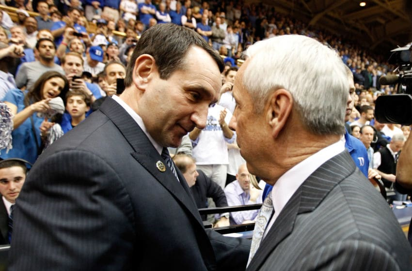 DURHAM, NC - MARCH 03: (L-R) Head coach Mike Krzyzewski of the Duke Blue Devils greets head coach Roy Williams of the North Carolina Tar Heels before their game at Cameron Indoor Stadium on March 3, 2012 in Durham, North Carolina. (Photo by Streeter Lecka/Getty Images)