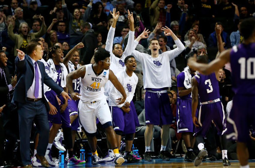 NEW YORK, NY - MARCH 18: Jared Johnson #3 of the Stephen F. Austin Lumberjacks celebrates with his bench in the second half against the West Virginia Mountaineers during the first round of the 2016 NCAA Men's Basketball Tournament at Barclays Center on March 18, 2016 in the Brooklyn borough of New York City. (Photo by Elsa/Getty Images)