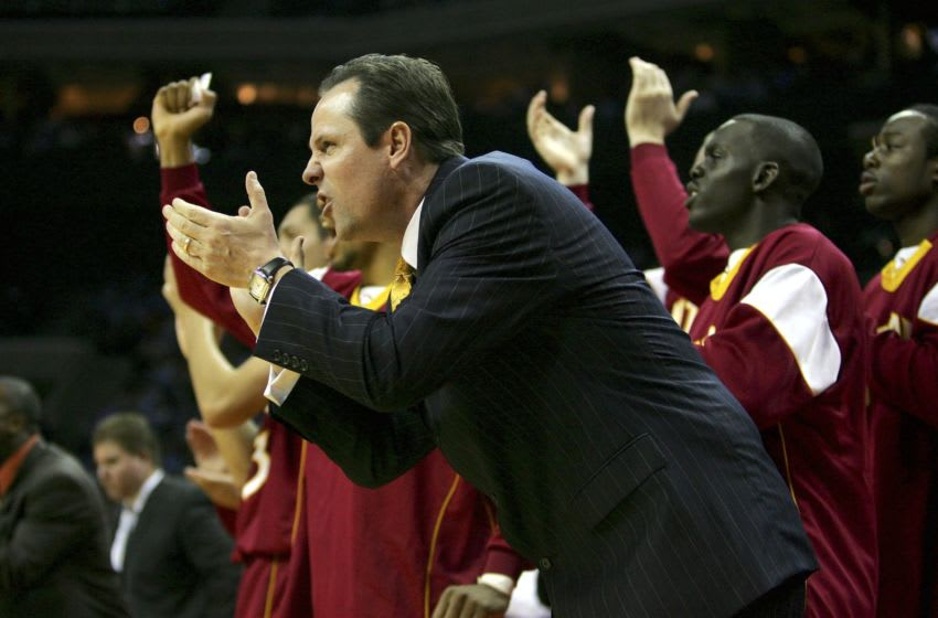 CHARLOTTE, NC - NOVEMBER 15: Head coach Greg Marshall of the Winthrop Eagles cheers on his team during a game against the University of North Carolina Tar Heels November 15, 2006 at the Charlotte Bobcats Arena in Charlotte, North Carolina. (Photo By Streeter Lecka/Getty Images)