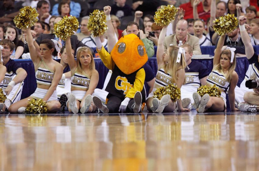 ATLANTA - MARCH 13: Mascot and cheerleaders of the Georgia Tech Yellow Jackets watches the action against the Florida State Seminoles during day two of the 2009 ACC Men's Basketball Tournament on March 13, 2009 at the Georgia Dome in Atlanta, Georgia. (Photo by Kevin C. Cox/Getty Images)