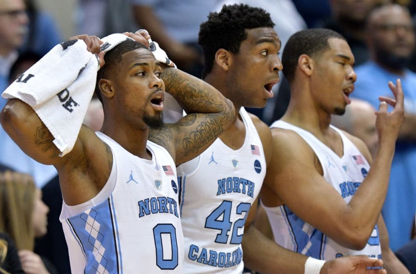 CHAPEL HILL, NC - FEBRUARY 27: (L-R) Seventh Woods #0, Brandon Huffman #42 and Garrison Brooks #15 of the North Carolina Tar Heels reacts during their loss to the Miami Hurricanes at the Dean Smith Center on February 27, 2018 in Chapel Hill, North Carolina. Miami won 91-88. (Photo by Grant Halverson/Getty Images)