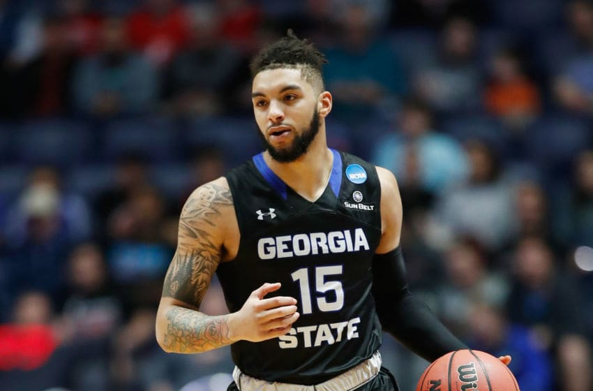 NASHVILLE, TN - MARCH 16: D'Marcus Simonds #15 of the Georgia State Panthers dribbles the ball up the court against the Cincinnati Bearcats during the game in the first round of the 2018 NCAA Men's Basketball Tournament at Bridgestone Arena on March 16, 2018 in Nashville, Tennessee. (Photo by Andy Lyons/Getty Images)