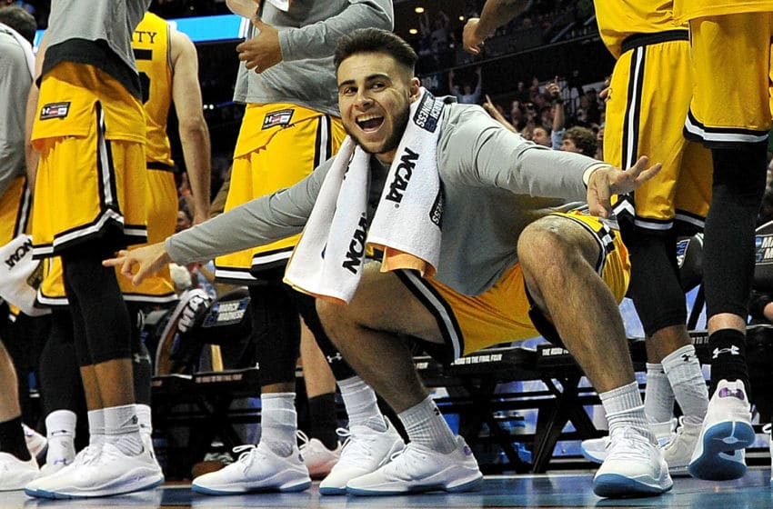 CHARLOTTE, NC - MARCH 16: Josh Rosario #1 of the UMBC Retrievers reacts from the bench during the second half of their game against the Virginia Cavaliers during the first round of the 2018 NCAA Men's Basketball Tournament at Spectrum Center on March 16, 2018 in Charlotte, North Carolina. (Photo by Jared C. Tilton/Getty Images)
