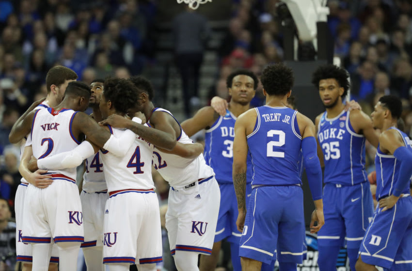 OMAHA, NE - MARCH 25: The Kansas Jayhawks and Duke Blue Devils huddle during the first half in the 2018 NCAA Men's Basketball Tournament Midwest Regional at CenturyLink Center on March 25, 2018 in Omaha, Nebraska. (Photo by Streeter Lecka/Getty Images)