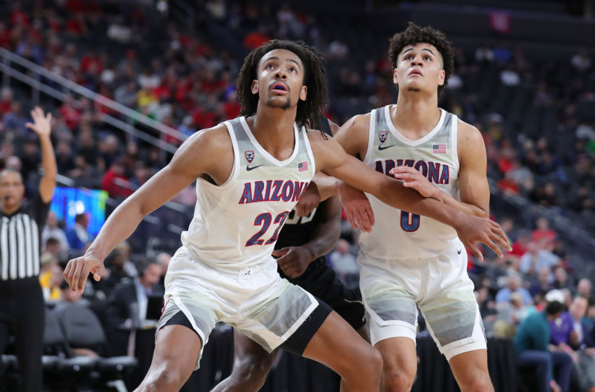 LAS VEGAS, NEVADA - MARCH 11: Zeke Nnaji #22 and Josh Green #0 of the Arizona Wildcats defended the rebound against Isaiah Stewart #33 of the Washington Huskies during the first round of the Pac-12 Conference basketball tournament at T-Mobile Arena on March 11, 2020 in Las Vegas, Nevada. (Photo by Leon Bennett/Getty Images)