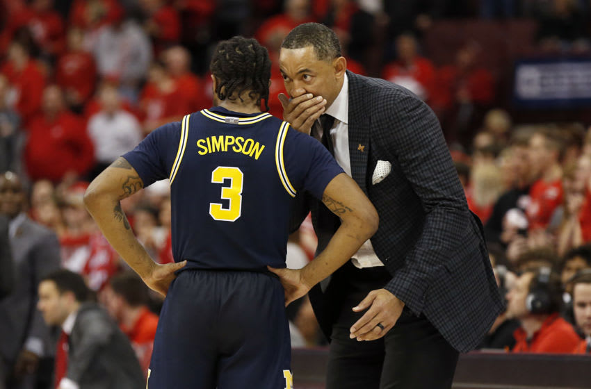 COLUMBUS, OHIO - MARCH 01: Head coach Juwan Howard of the Michigan Wolverines talks with Zavier Simpson #3 of the Michigan Wolverines in the game against the Ohio State Buckeyes at Value City Arena on March 01, 2020 in Columbus, Ohio. (Photo by Justin Casterline/Getty Images)