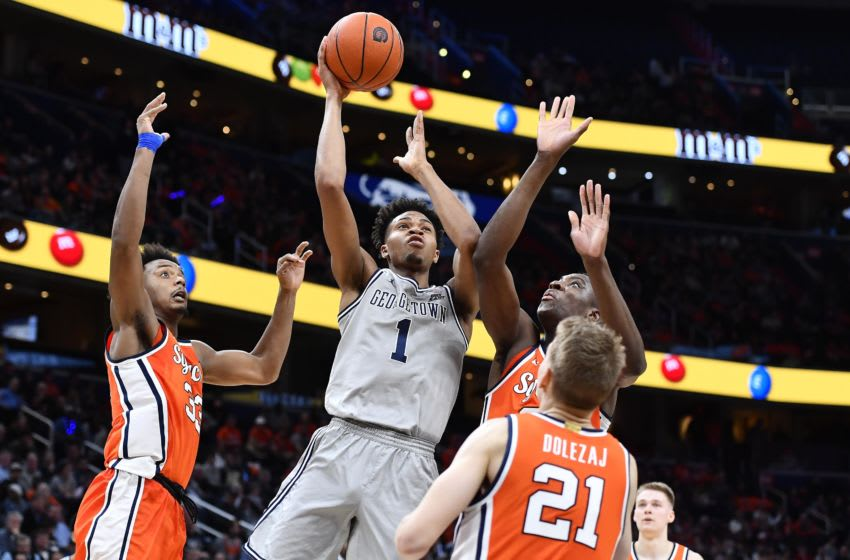 Dec 14, 2019; Washington, DC, USA; Georgetown Hoyas forward Jamorko Pickett (1) shoots the ball over Syracuse Orange forward Elijah Hughes (33) and forward Bourama Sidibe (34) and forward Marek Dolezaj (21) during the second half at Capital One Arena. Mandatory Credit: Brad Mills-USA TODAY Sports