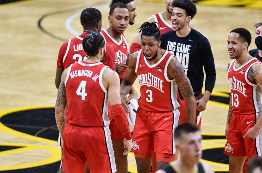 Feb 4, 2021; Iowa City, Iowa, USA; Ohio State Buckeyes guard Eugene Brown III (3) and guard CJ Walker (13) and Ohio State Buckeyes guard Duane Washington Jr. (4) react after the game against the Iowa Hawkeyes at Carver-Hawkeye Arena. Mandatory Credit: Jeffrey Becker-USA TODAY Sports