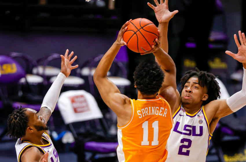Feb 13, 2021; Baton Rouge, Louisiana, USA; Tennessee Volunteers guard Jaden Springer (11) shoots a jump shot over LSU Tigers forward Trendon Watford (2) at Pete Maravich Assembly Center. Mandatory Credit: Stephen Lew-USA TODAY Sports