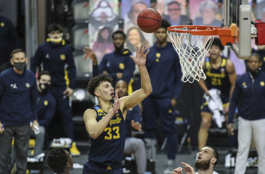 Feb 14, 2021; Newark, New Jersey, USA; Marquette Golden Eagles forward Dawson Garcia (33) puts up a jump shot in the second half against the Seton Hall Pirates at Prudential Center. Mandatory Credit: Wendell Cruz-USA TODAY Sports