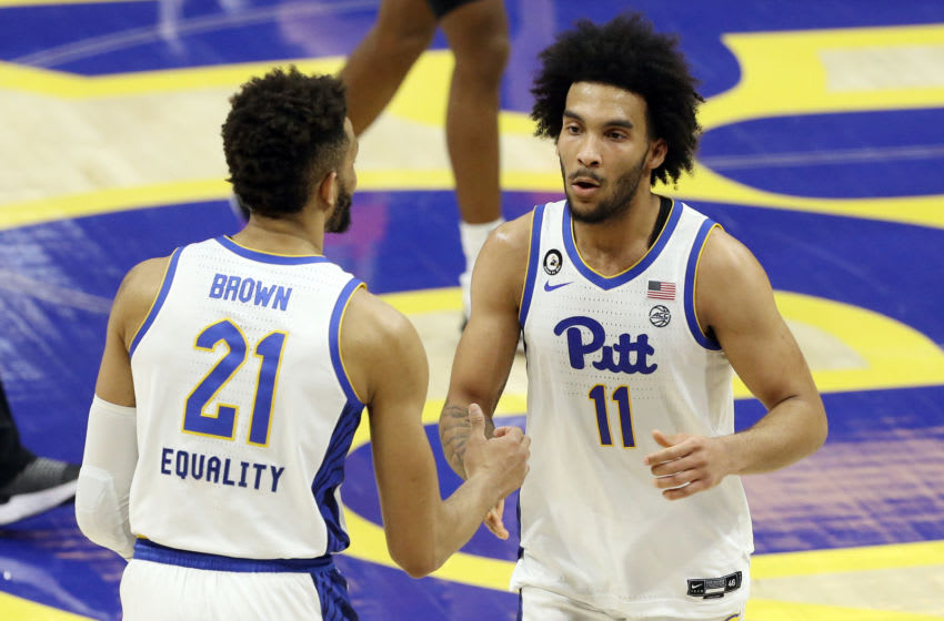 Mar 2, 2021; Pittsburgh, Pennsylvania, USA; Pittsburgh Panthers forward Terrell Brown (21) and forward Justin Champagnie (11) celebrate after defeating the Wake Forest Demon Deacons at the Petersen Events Center. Mandatory Credit: Charles LeClaire-USA TODAY Sports