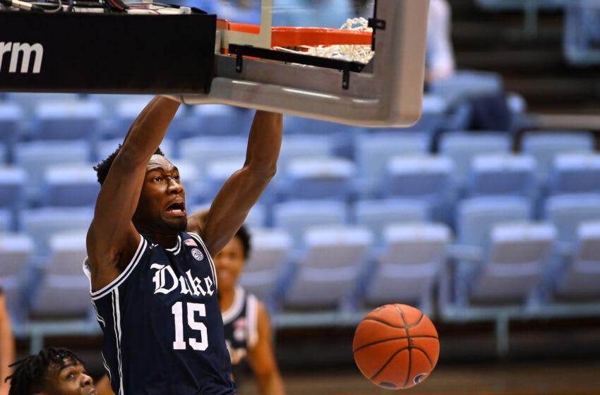 Mar 6, 2021; Chapel Hill, North Carolina, USA; Duke Blue Devils center Mark Williams (15) scores in the second half at Dean E. Smith Center. Mandatory Credit: Bob Donnan-USA TODAY Sports