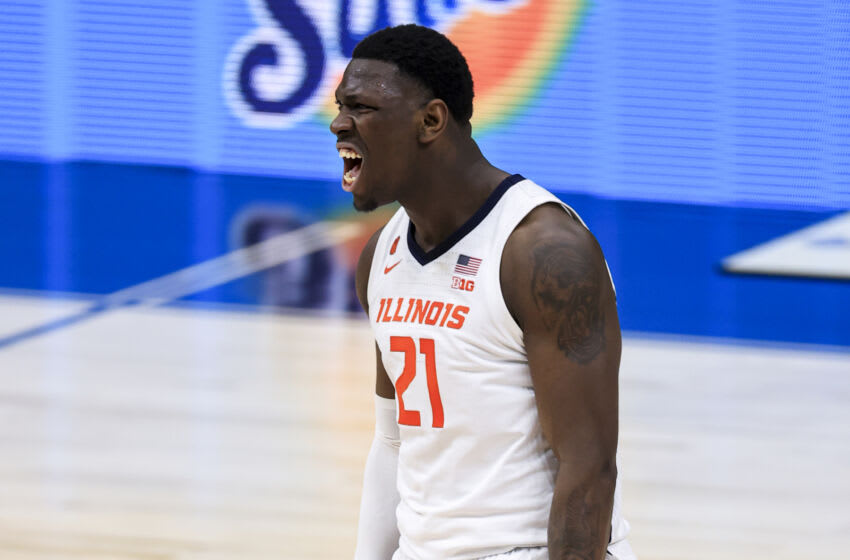 Mar 12, 2021; Indianapolis, Indiana, USA; Illinois Fighting Illini center Kofi Cockburn (21) reacts to dunking the ball against the Rutgers Scarlet Knights in the first half at Lucas Oil Stadium. Mandatory Credit: Aaron Doster-USA TODAY Sports
