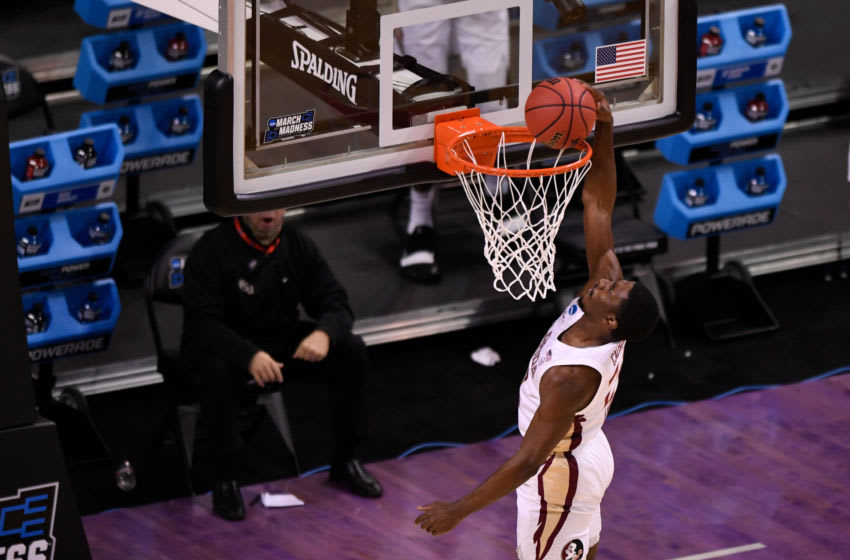 Mar 22, 2021; Indianapolis, Indiana, USA; Florida State Seminoles guard Sardaar Calhoun (24) dunks the ball in the second half against the Colorado Buffaloes in the second round of the 2021 NCAA Tournament at Indiana Farmers Coliseum. Mandatory Credit: Doug McSchooler-USA TODAY Sports