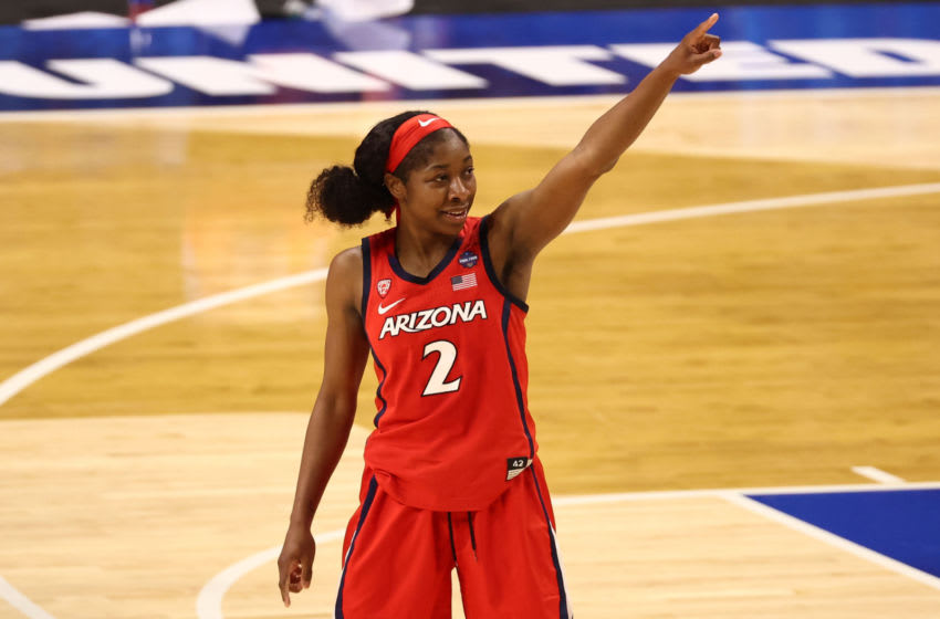 Apr 2, 2021; San Antonio, Texas, USA; Arizona Wildcats guard Aari McDonald (2) reacts while walking off the court after defeating the UConn Huskies in the national semifinals of the women's Final Four of the 2021 NCAA Tournament at Alamodome. Mandatory Credit: Troy Taormina-USA TODAY Sports