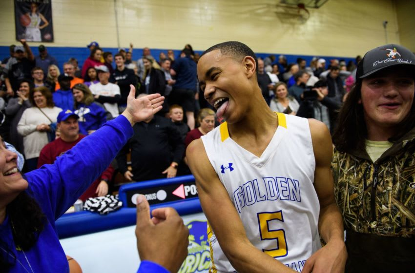 Wren's Bryce McGowens (5) celebrates with loved ones after beating Greenville 71-68 Tuesday, Feb. 19, 2019. Jm Wren 021919 030