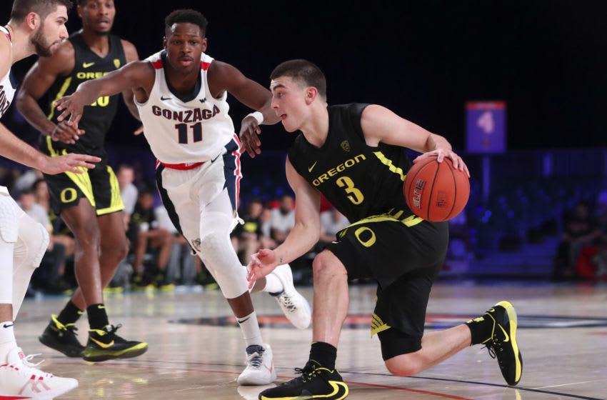 Nov 28, 2019; Nassau, BHS; Oregon Ducks guard Payton Pritchard (3) dribbles as Gonzaga Bulldogs guard Joel Ayayi (11) defends during the first half at Imperial Arena. Mandatory Credit: Kevin Jairaj-USA TODAY Sports