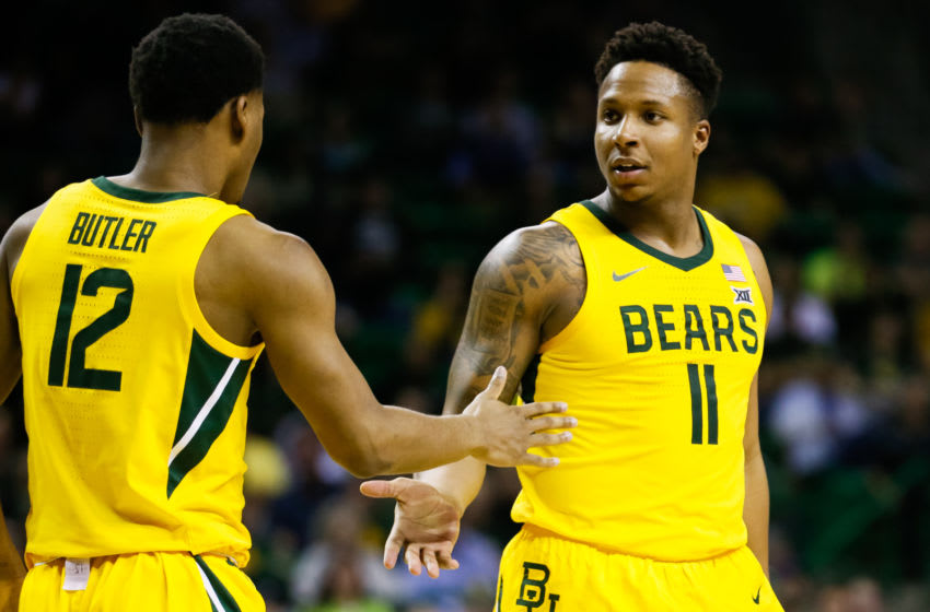Feb 8, 2020; Waco, Texas, USA; Baylor Bears guard Jared Butler (12) and guard Mark Vital (11) slap hands after a basket during the second half against the Oklahoma State Cowboys at Ferrell Center. Mandatory Credit: Raymond Carlin III-USA TODAY Sports