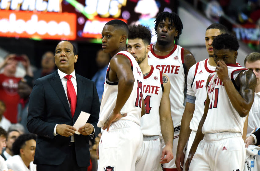 Feb 19, 2020; Raleigh, North Carolina, USA; North Carolina State Wolfpack head coach Kevin Keatts (left) and his team await a review during the second half against the Duke Blue Devils at PNC Arena. The Wolfpack won 88-66. Mandatory Credit: Rob Kinnan-USA TODAY Sports