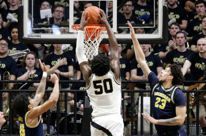 Purdue forward Trevion Williams (50) goes up for a dunk between Michigan guard Eli Brooks (55) and Michigan forward Brandon Johns Jr. (23) during the first half of a NCAA men's basketball game, Saturday, Feb. 22, 2020 at Mackey Arena in West Lafayette. Bkc Purdue Vs Michigan