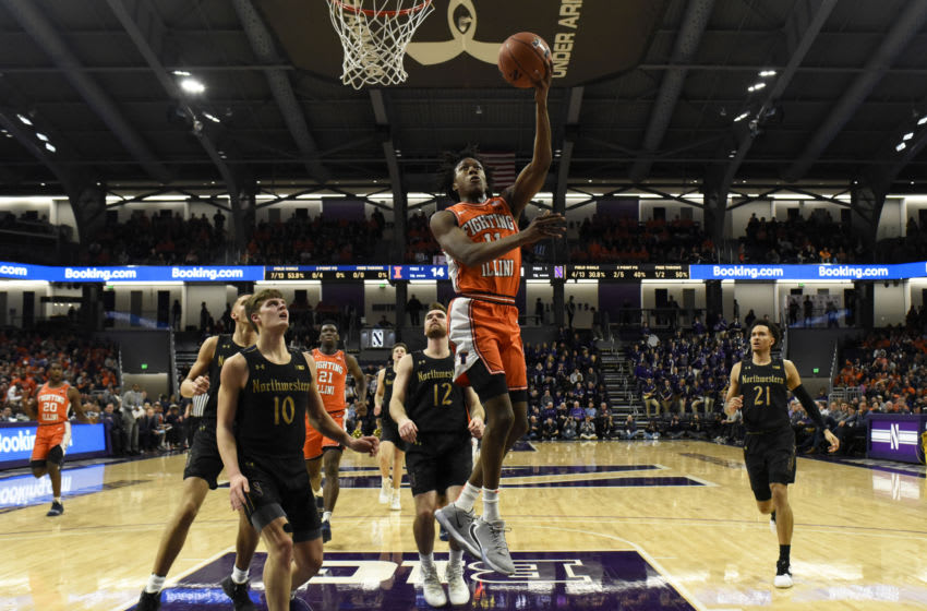 Feb 27, 2020; Evanston, Illinois, USA; Illinois Fighting Illini guard Ayo Dosunmu (11) goes to the basket as Northwestern Wildcats forward Miller Kopp (10) stands nearby during the first half at Welsh-Ryan Arena. Mandatory Credit: David Banks-USA TODAY Sports