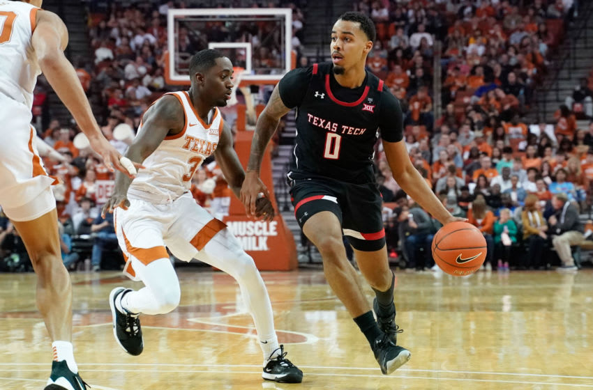 Feb 8, 2020; Austin, Texas, USA; Texas Tech Red Raiders guard Kyler Edwards (0) drives to the basket against Texas Longhorns guard Courtney Ramey (3) in the second half at Frank C. Erwin Jr. Center. Mandatory Credit: Scott Wachter-USA TODAY Sports
