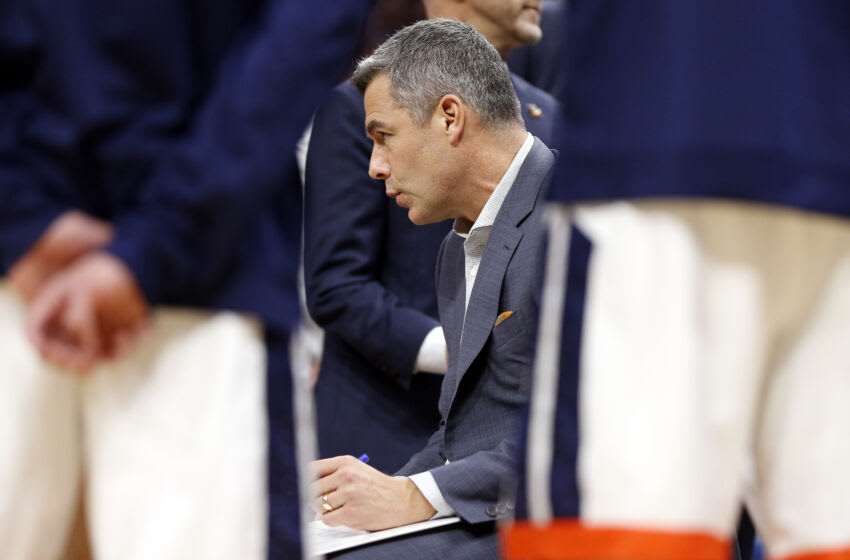 Mar 7, 2020; Charlottesville, Virginia, USA; Virginia Cavaliers head coach Tony Bennett huddles with players during a timeout in the first half against the Louisville Cardinals at John Paul Jones Arena. Mandatory Credit: Amber Searls-USA TODAY Sports