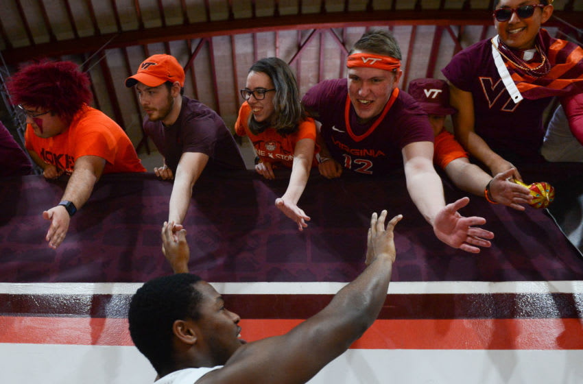 Mar 4, 2020; Blacksburg, Virginia, USA; Virginia Tech Hokies students high five guard Jalen Cone (15) following the victory against the Clemson Tigers at Cassell Coliseum. Mandatory Credit: Michael Thomas Shroyer-USA TODAY Sports