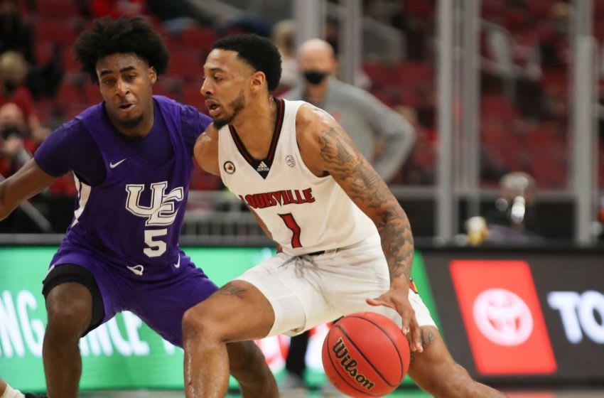 Louisville's Carlik Jones drives against Evansville's Shamar Givance in the first half at the KFC Yum! Center on Wednesday, November 25, 2020, in Louisville, Kentucky. Louisville won 79-44 Cardsevansville31