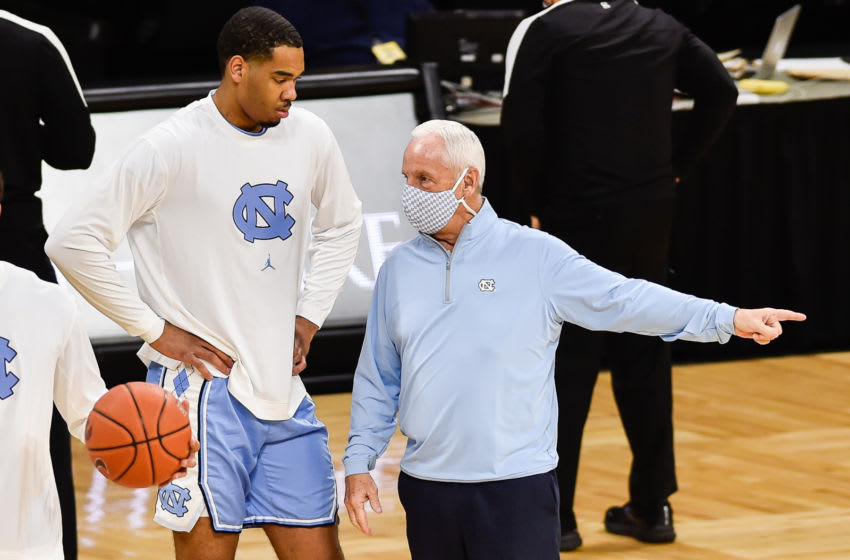 Dec 8, 2020; Iowa City, Iowa, USA; North Carolina Tar Heels head coach Roy Williams talks with a member of his team before the game against the Iowa Hawkeyes at Carver-Hawkeye Arena. Mandatory Credit: Jeffrey Becker-USA TODAY Sports