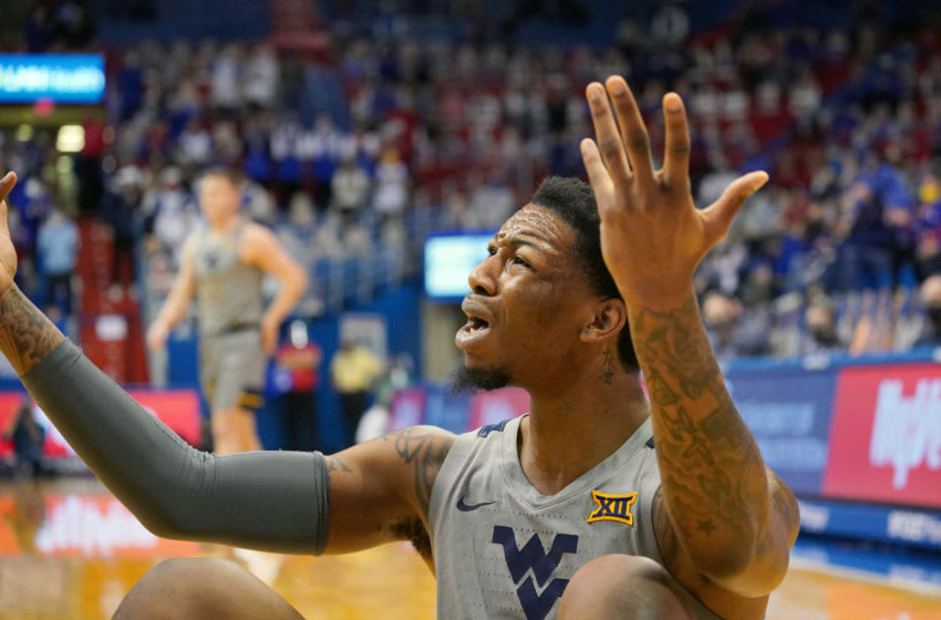 Dec 22, 2020; Lawrence, Kansas, USA; West Virginia Mountaineers forward Gabe Osabuohien (3) reacts after a call by an official during the first half against the Kansas Jayhawks at Allen Fieldhouse. Mandatory Credit: Denny Medley-USA TODAY Sports