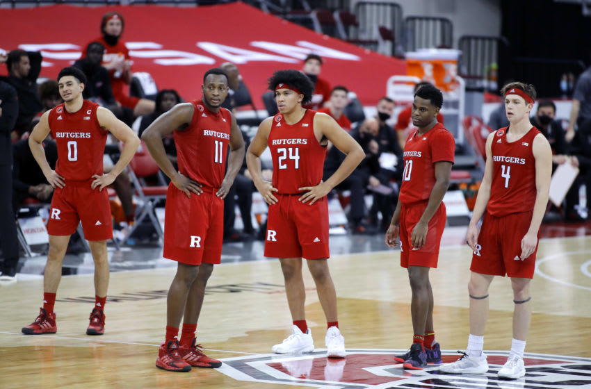 Dec 23, 2020; Columbus, Ohio, USA; Rutgers Scarlet Knights guard Ron Harper Jr. (24) and teammates watch as the Ohio State Buckeyes pull ahead on technical fouls shots during the second half at Value City Arena. Mandatory Credit: Joseph Maiorana-USA TODAY Sports