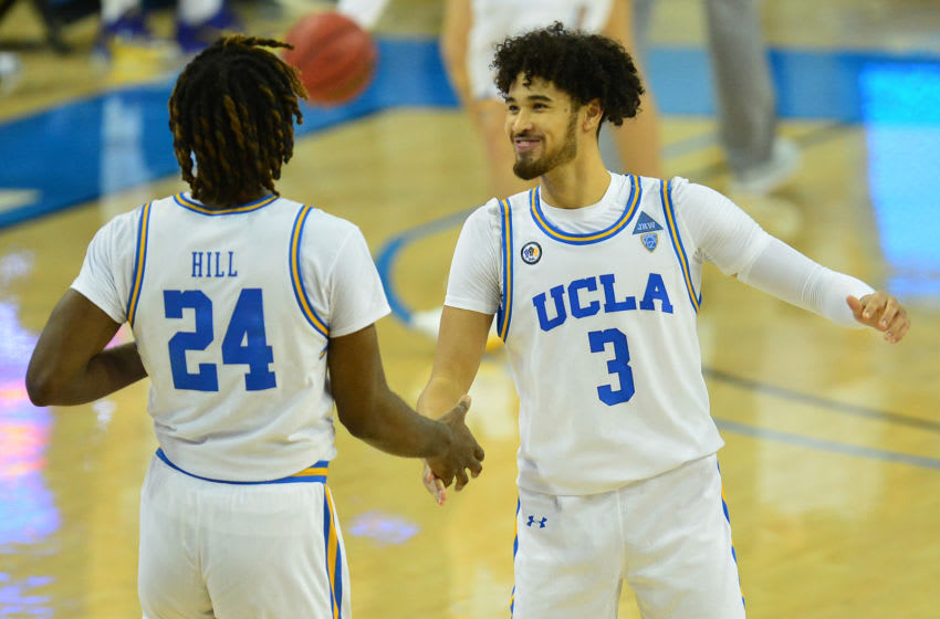 Dec 31, 2020; Los Angeles, California, CA; UCLA Bruins guard Johnny Juzang (3) and forward Jalen Hill (24) celebrate the 72-70 victory against the Utah Utes at Pauley Pavilion. Mandatory Credit: Gary A. Vasquez-USA TODAY Sports