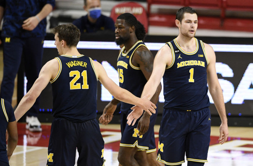 Dec 31, 2020; College Park, MD, USA; Michigan center Hunter Dickinson (1) and guard Franz Wagner (21) react during the second half of an NCAA college basketball game against Maryland, Thursday, Dec. 31, 2020, in College Park, Md. Michigan won 84-73. Mandatory Credit: Nick Wass/Pool Photo-USA TODAY Sports