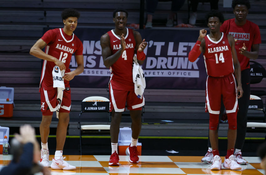 Jan 2, 2021; Knoxville, Tennessee, USA; Alabama Crimson Tide forward Darius Miles (12) and forward Juwan Gary (4) and guard Keon Ellis (14) react to a play against the Tennessee Volunteers during the second half at Thompson-Boling Arena. Mandatory Credit: Randy Sartin-USA TODAY Sports