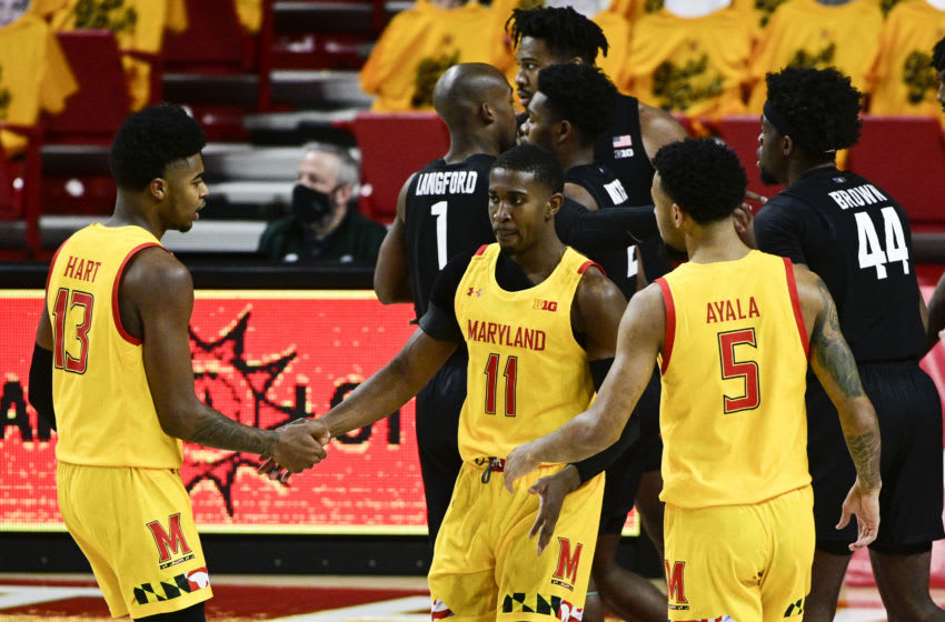 Feb 28, 2021; College Park, Maryland, USA; Maryland Terrapins guard Darryl Morsell (11) meets with guard Hakim Hart (13) and guard Eric Ayala (5) during a stoppage of play during the first half against the Michigan State Spartans at Xfinity Center. Mandatory Credit: Tommy Gilligan-USA TODAY Sports